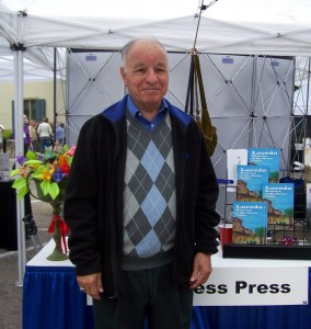 Deacon Jose Guadalupe Diaz, with his book, Laredo: Memoirs of My Home Town